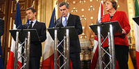 Sarkozy thinks global, should look local