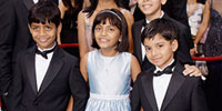 """Slumdog"" sweeps Oscars, draws mixed reactions in India"