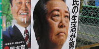 Clinton plans for a rare meeting with Japan's opposition