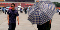 Police, umbrellas block view of Tiananmen on anniversary