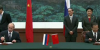 In China, Putin inks major deals on energy, high-speed rail
